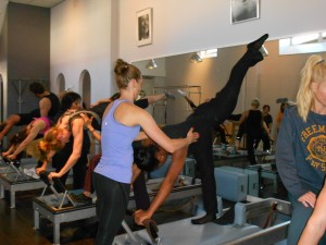 Marjorie doing The arabesque on The Reformer