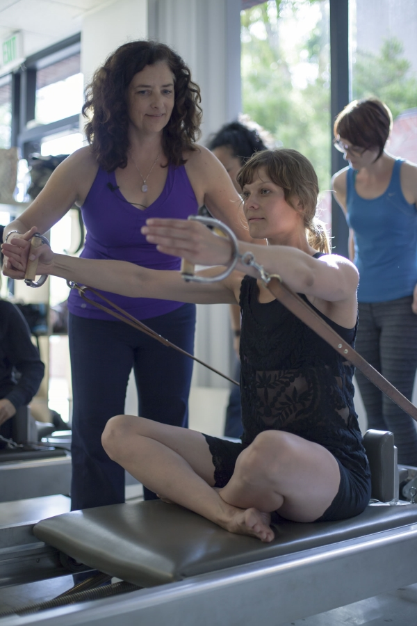 Karen assisting with The Rowing serie on The Reformer