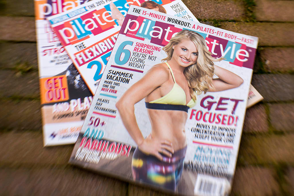 Laura on the cover of Pilatesstyle